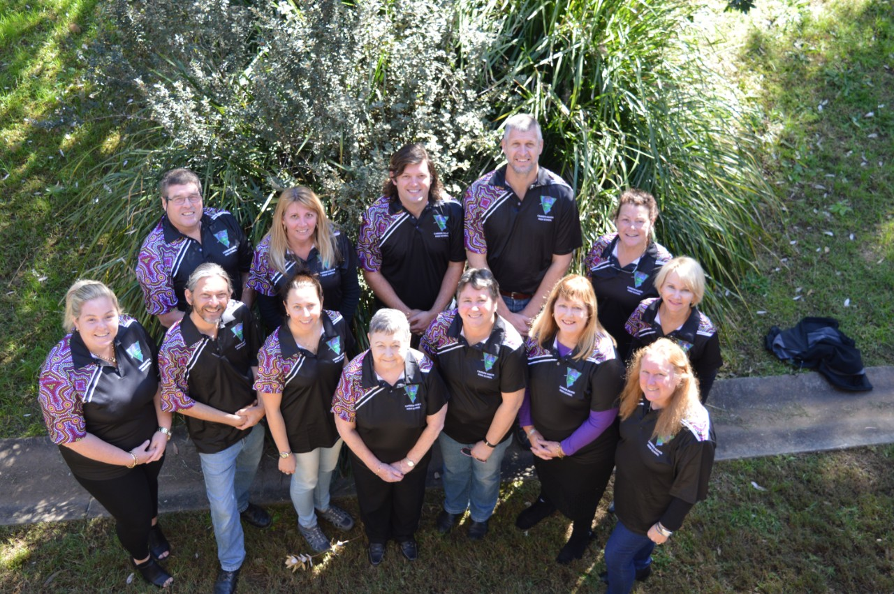 Group of staff in naidoc shirts