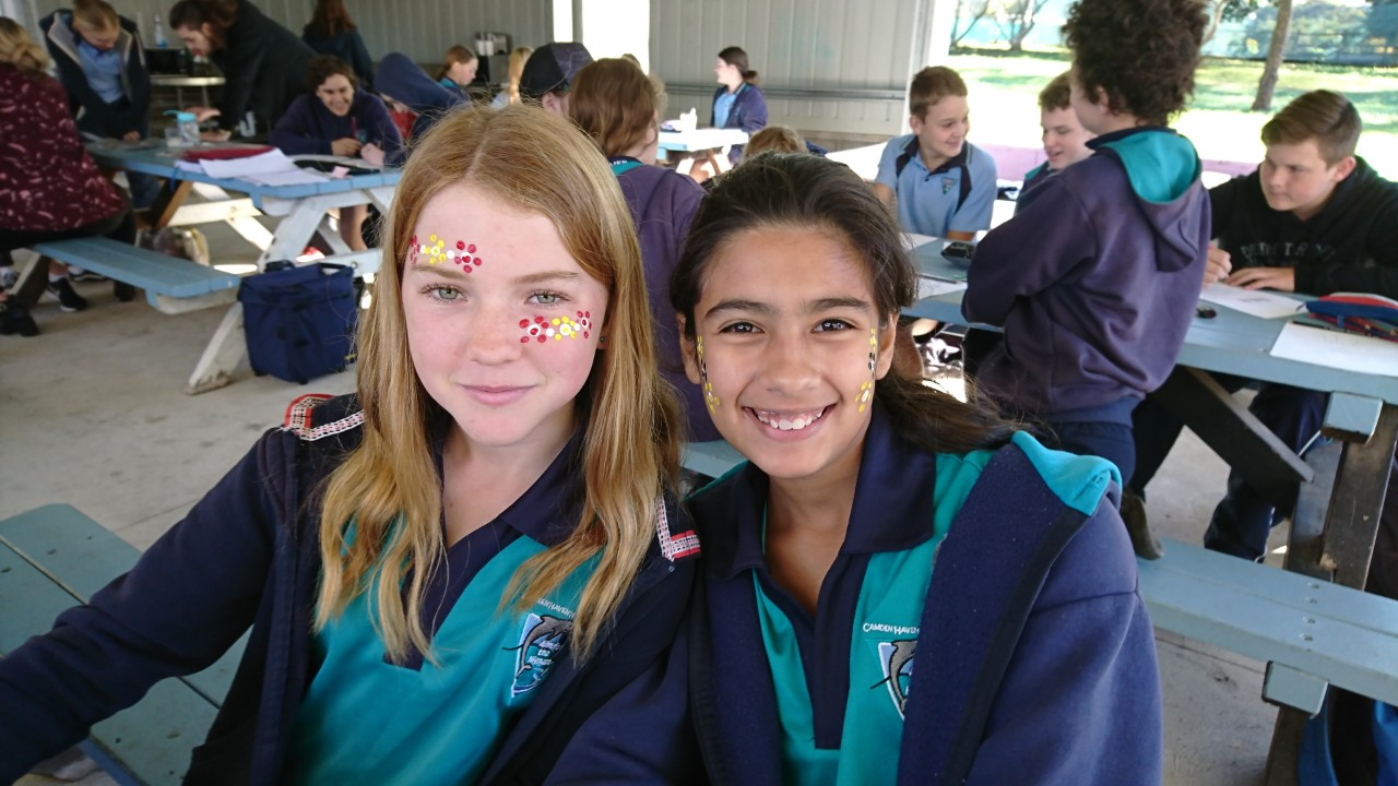 Two girls with aboriginal paint on their face